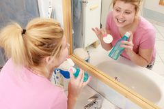 Woman applying tonic on cotton pad. Skin toning, proper pH complexion concept. Woman applying tonic on cotton pad Royalty Free Stock Photography