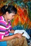 Woman applying wax on batik Royalty Free Stock Photo
