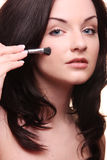 Woman applyng make-up Royalty Free Stock Photography