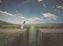 Woman approaching broken road. A woman comes to pit in the road and must slow down Royalty Free Stock Photography