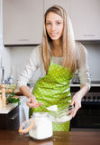 Woman  in apron with  flour Royalty Free Stock Photography