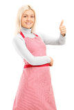 Woman with an apron giving a thumb up Stock Image