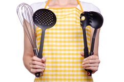 Woman in apron in hands kitchen tools corolla ladle. On white background isolation stock images