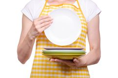 Woman in apron in hands plates stock image