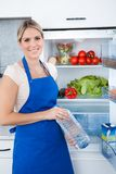 Woman In Apron Holding Bottle Stock Photo