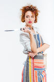 Woman in apron holding knife Stock Photos