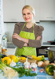 Woman in apron at home kitchen Royalty Free Stock Photography