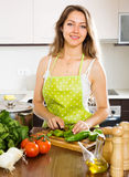 Woman in apron  at kitchen Stock Photo