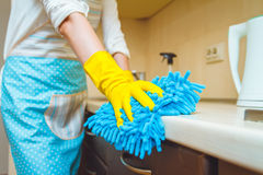 The woman in an apron makes cleaning Stock Images