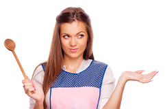 Woman with apron and mixing spoon Royalty Free Stock Images