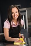 Woman in apron on modern kitchen Stock Photo
