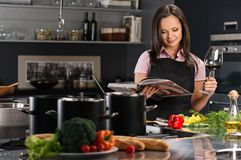 Woman in apron on modern kitchen Stock Images