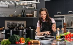 Woman in apron on modern kitchen Royalty Free Stock Photo