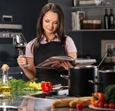 Woman in apron on modern kitchen Stock Photos