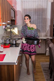 Woman in apron on modern kitchen Royalty Free Stock Photo