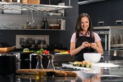 Woman in apron on a modern kitchen Stock Photo