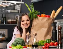 Woman in apron on a modern kitchen Royalty Free Stock Photography