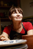 Woman in apron and red shirt Royalty Free Stock Image