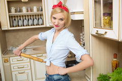 Woman in apron with rolling pin in hand in the Royalty Free Stock Image
