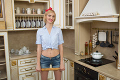 Woman in apron with rolling pin in hand in the Stock Images