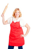 Woman with apron and rolling pin Stock Image