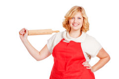 Woman with apron and rolling pin Stock Photography
