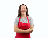 Woman with apron smiling Stock Images