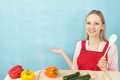 Woman in Apron with Vegetables Stock Photography