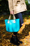 Woman with aqua bag Stock Photo