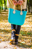 Woman with aqua bag Royalty Free Stock Photography