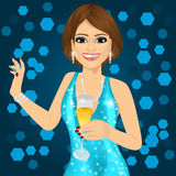 Woman in aqua sparkling dress holding a champagne glass Royalty Free Stock Photos