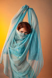Woman in arabian costume hide face with veil Royalty Free Stock Images