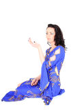 Woman in arabian dress sitting Royalty Free Stock Photo