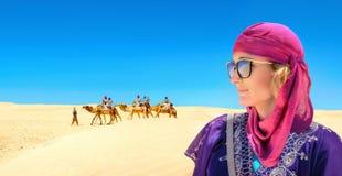 Woman in arabic traditional clothing. Sahara desert. Tunisia, North Africa stock image