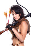 Woman with arbalest. Full-length portrait of beautiful woman fur hunter with crossbow on gray Royalty Free Stock Image