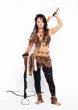 Woman with arbalest. Full-length portrait of beautiful woman fur hunter with crossbow on gray Stock Image