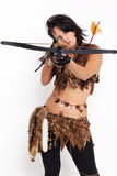 Woman with arbalest. Portrait of beautiful woman fur hunter with crossbow aiming at the camera Royalty Free Stock Photos