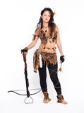 Woman with arbalest. Full-length portrait of beautiful woman fur hunter with crossbow on gray Stock Photo