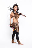 Woman with arbalest. Full-length portrait of beautiful woman fur hunter with crossbow on gray Stock Photography