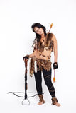 Woman with arbalest. Full-length portrait of beautiful woman fur hunter with crossbow on gray Stock Images