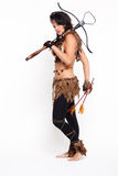 Woman with arbalest. Full-length portrait of beautiful woman fur hunter with crossbow on gray Royalty Free Stock Photography