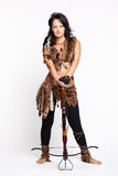 Woman with arbalest. Full-length portrait of beautiful woman fur hunter with crossbow on gray Royalty Free Stock Images