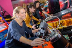 Woman on arcade motorcycle. Arcade Stock Images