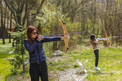 Woman archer shooting with his bow at an outdoor Royalty Free Stock Images