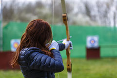 Woman archer shooting with his bow at an outdoor Royalty Free Stock Image