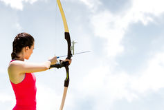 Woman archery against sky Royalty Free Stock Photo