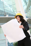 Woman Architect. A pretty woman architect inspecting the blueprints Royalty Free Stock Photo