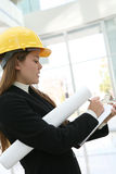 Woman Architect. A pretty woman architect holding blueprints and a clipboard Royalty Free Stock Images