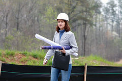 Woman Architect. Young Woman Architect on construction site Stock Photography
