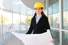 Woman Architect  with blueprints Royalty Free Stock Image